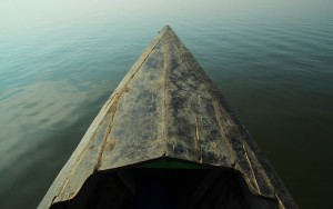 Old, wooden, boat tip on calm water